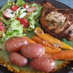 MARINATED GRILLED PORK CHOPS WITH A COMPOUND BUTTER AND A GREEK VINAIGRETTE