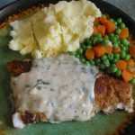 PAN FRIED WHITE FISH WITH A TARRAGON PARSLEY WHITE WINE SAUCE